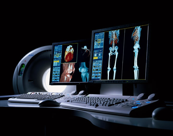 Using a series of X-ray beans, a CT scanner creates cross-sectional images of the body.